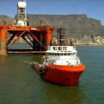 Pacific Brigand towing oil rig out of Capetown